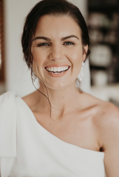 Lady in white dress smiling