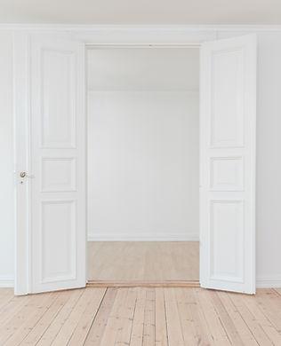 white open door_philipp-berndt-unsplash.