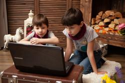 Canva - Boys Looking At Laptop Screen