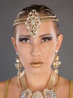 Headshot of woman in gold jewelry - Medford photographer John Neilson
