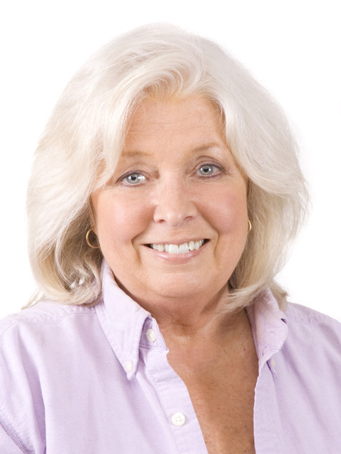 Business headshot of mature woman in pink dress shirt - Medford photography