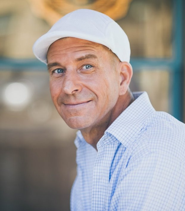 Photo of a man wearing a white hat