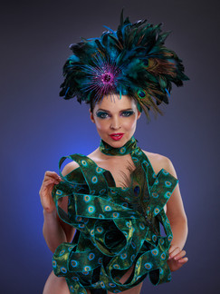 Photo of woman with feather headpiece and ribbon - Medford photographer John Neilson