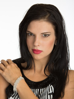 Dark haired woman with red lips and bracelets - Medford photographer, John Neilson
