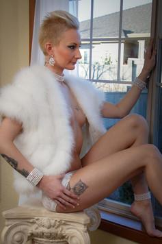 White fur and tattoos
