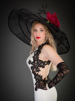 Photo of blonde woman in large black hat - Medford photographer John Neilson