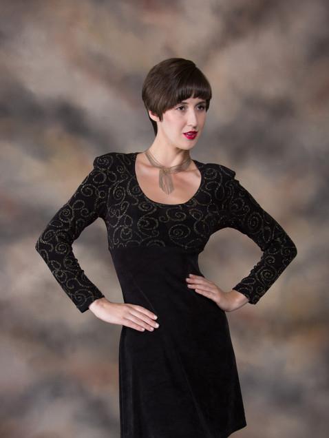 Woman with short dark hair in short black dress - Medford photographer, John Neilson