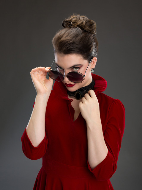 Photo of woman in red coat and sunglasses - Medford photographer John Neilson