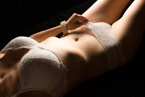 White lingerie with pearl bracelet