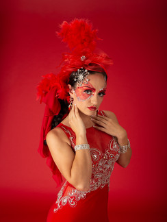 Photo of woman in red gown and red feather headpiece - Medford photographer John Neilson