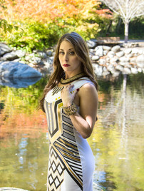 Portrait photo of brunette woman outdoor by pond - Medford photographer, John Neilson