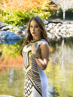 Woman in white and gold dress standing outside by pond - Medford photographer, John Neilson