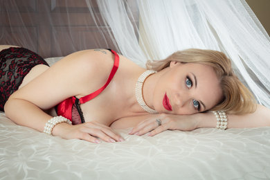 Blue eyes and red lingerie - by Oregon boudoir photographer, John Neilson