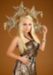 Creative photo of blonde woman in gold costume with metallic stars - Medford Photographer, John Neilson