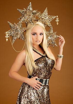 Creative photo of blonde woman in gold costume with metallic stars - Medford Photographer, John Neilson