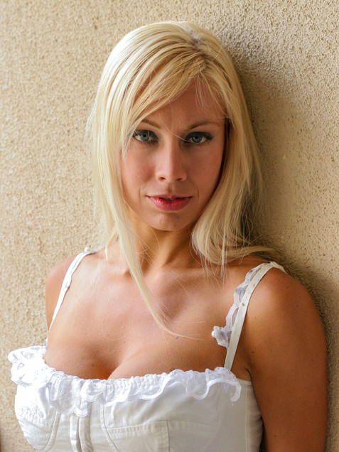 Blonde woman in white tank top leaning against wall - Medford photographer, John Neilson