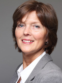 Business headshot of woman in gray suit with short dark hair - Medford photography
