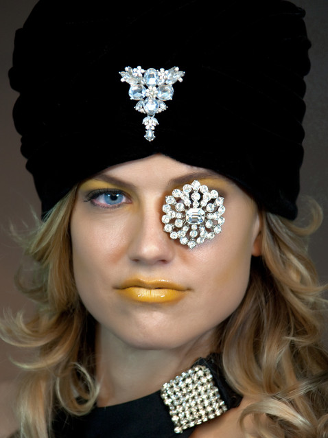 Photo of blonde woman in black hat with gold lipstick - Medford photographer John Neilson