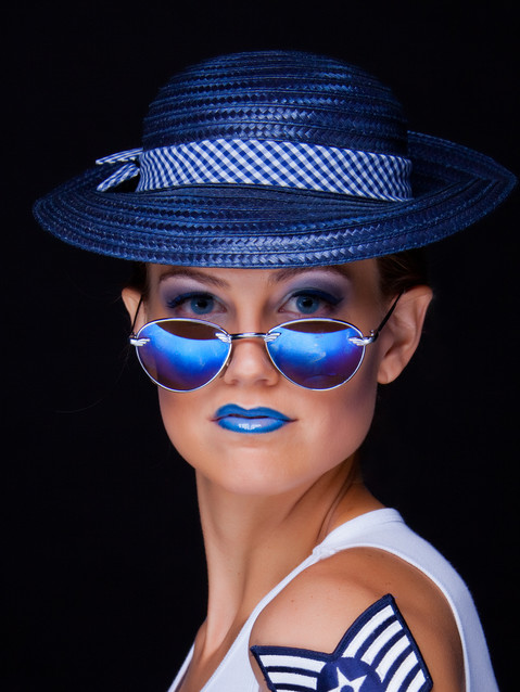 Photo of woman in sunglasses and blue hat - Medford photographer John Neilson