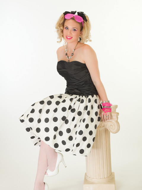 Photo of blonde woman in polka dot 80s dress - Medford photographer John Neilson