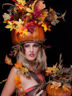 Photo of blonde woman with pumpkins and fall leaves - Medford photographer John Neilson