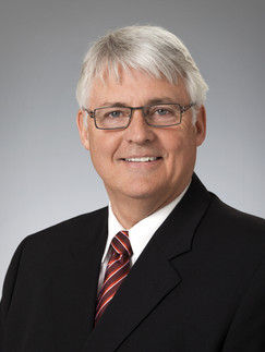 Business headshot of man wearing glasses - Medford photography