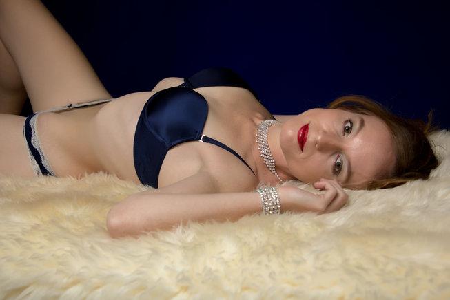 Blue lingerie on fur - by Oregon boudoir photographer, John Neilson