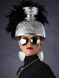 Photo of woman in black dress and silver helmet - Medford photographer John Neilson
