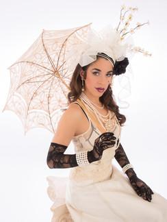 Photo of brunette woman in white victorian costume - Medford photographer John Neilson