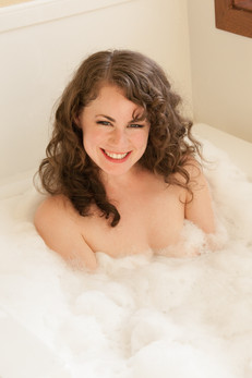 Brunette in bathtub smiling