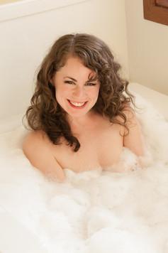 Brunette in bathtub smiling