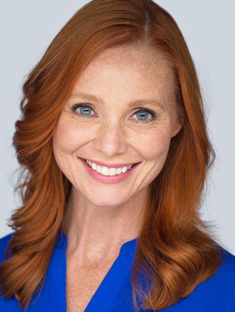 Business headshot red haired woman in blue shirt - Medford photography