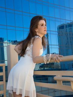 Brunette woman in white dress on balcony - Medford photographer, John Neilson
