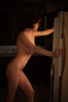 Model looking in refrigerator