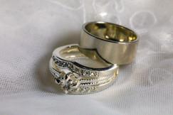 Two gold wedding rings sitting on white veil - by Southern Oregon Photographer, John Neilson of Oregon Studio Group