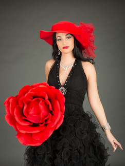 Photo of woman in black dress with large red rose - Medford photographer John Neilson