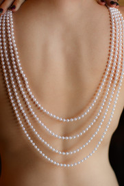 Nude back with pearls