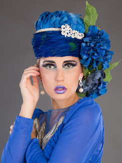 Photo of woman in blue dress with floral hat - Medford photographer John Neilson