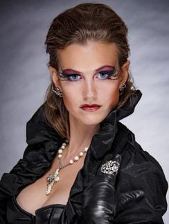 Photo of woman in black leather with makeup - Medford photographer John Neilson