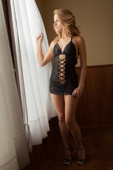 Black chemise looking out window