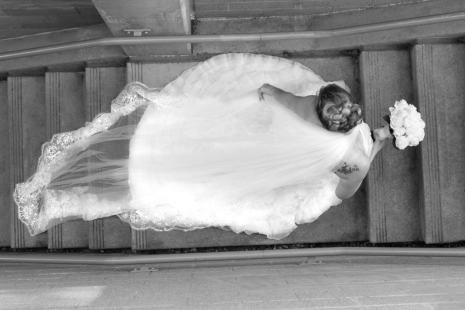 Oregon Wedding photography - Bride with updo hair and long veil walking upstairs