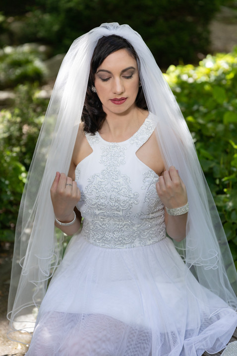 Wedding photo of brunette bride with short gown and veil - by Southern Oregon Photographer, John Neilson of Oregon Studio Group