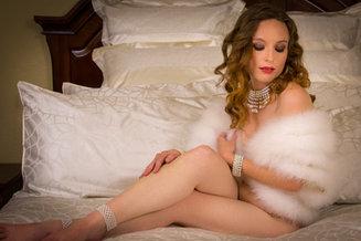 White fur shawl on bed - by Oregon boudoir photographer, John Neilson
