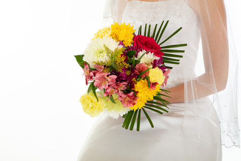 Photo of bride holding tropical bouquet of flowers - by Southern Oregon Photographer, John Neilson of Oregon Studio Group