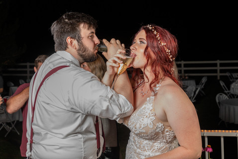 Bride and groom sipping champagne at a Central Point backyard wedding - by Southern Oregon Photographer, John Neilson of Oregon Studio Group