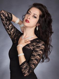 Dark haired woman in black lace sleeve dress - Medford photographer, John Neilson