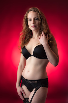 Black lingerie with red background
