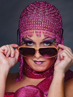 Photo of woman in pink hat and sunglasses - Medford photographer John Neilson
