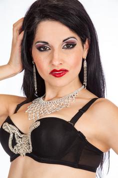 Black rhinestone bra and red lips