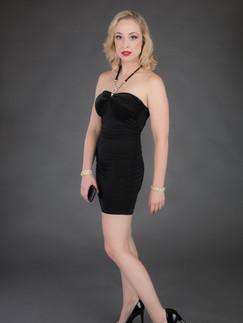 Blonde woman in black cocktail dress and high heels - Medford photographer, John Neilson